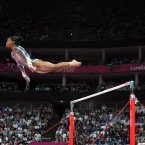 USA's Gabrielle Douglas competes during the Artistic Gymnastics women's uneven bars final at the North Greenwich Arena, London Anthony Devlin/PA Wire.