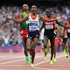 Great Britain's Mo Farah celebrates as he crosses the line, winning the gold medal in the Men's 5000m final, on the 15th day of the London 2012 Olympics at The Olympic Stadium. PRESS ASSOCIATION Photo. Picture date: Saturday August 11, 2012. See PA story OLYMPICS . Photo credit should read: Martin Rickett/PA Wire. EDITORIAL USE ONLY