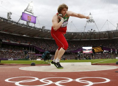 Belarus' Nadzeya Ostapchuk takes a throw in the women's shot put final