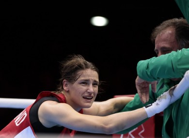 Katie Taylor celebrates winning her fight against Russia's Sofya Ochigava.
