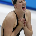 United States' Missy Franklin celebrates after  the women's 4 x 100-meter medley relay final at the Aquatics Centre in the Olympic Park during the 2012 Summer Olympics, London, Saturday, Aug. 4, 2012. (AP Photo/Jae C. Hong)