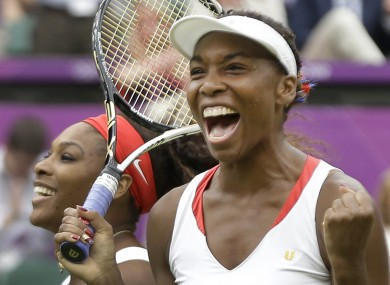 Venus Williams, right, and Serena Williams of the United States celebrate their victory against Andrea Hlavackova and Lucie Hradecka of the Czech Republic during the gold medal women's doubles match.