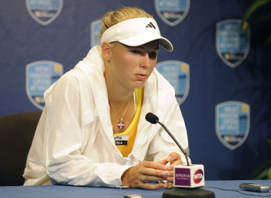 A disappointed Caroline Wozniacki speaks with reporters after retiring from her semifinal match. 