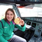Olympic gold medalist Katie Taylor in the cockpit of the plane.