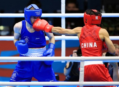 reland's Paddy Barnes (Blue) in action against Shiming Zou (Red) of China.