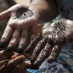 A Pakistani girl gets her hands painted with henna in preparation for the upcoming Eid al-Fitr festival, in Karachi, Pakistan, Saturday. Eid al-Fitr marks the end of the holy month of Ramadan. (AP Photo/Fareed Khan)