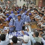 Pakistanis buy food from a stall to break their fast, during the Muslim holy fasting month of Ramadan, in Karachi, Pakistan. (AP Photo/Shakil Adil)