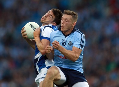 Laois player Colm Begley is challenged by Dublin's Paul Flynn.