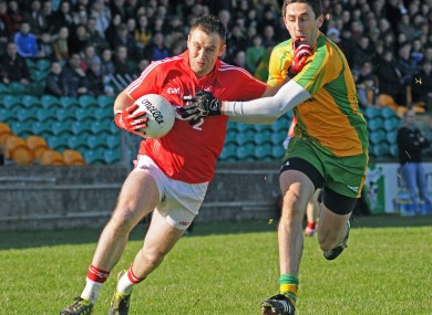 Cork's Paul Kerrigan and Rory Kavanagh of Donegal.