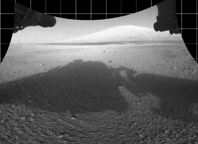 Curiosity captures its own shadow in photo from Mars showing the view from beneath the rover. 