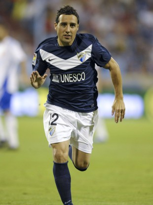 Cazorla playing for Malaga.