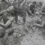 Tourists play with the mud during the Boryeong Mud Festival on Daecheon Beach in Boryeong, South Korea, July 2012. Pic: AP Photo/Ahn Young-joon