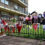 Flowers outside the block of flats where Natalie Sharp, mother of Tia Sharp lives. Photo: Gareth Fuller/PA Wire