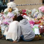 Two mourners comfort each other at the makeshift shrine for Tia Sharp. Photo: Max Nash/PA Wire