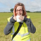 Car parking steward Alice McAlpine enjoys a cup of tea, made for her by one of the recently parked festival attendees, in car park c on the second day of the Electric Picnic music and arts festival in Stradbally Co Laois. Photo: Laura Hutton/Photocall Ireland