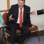 James Reilly is going to transport that phone into his hand by telekinesis. 