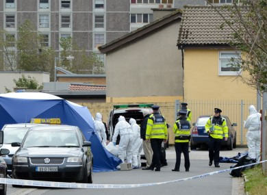 The scene outside the house in Ballymun yesterday 