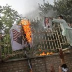 Afghans burn the US and Israeli flags during flags in Kabul, Afghanistan, Sunday, September 16, during a protest against an Internet video that mocks the Prophet Muhammad . 