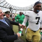 An Taoiseach Enda Kenny greets Notre Dame player Stephon Tuitt with a friendly box. INPHO/Cathal Noonan