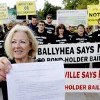 Eithne Keating from the Ballyhea protest group with a petition against bank bailouts before marching to Leinster House. Photo credit: Julien Behal/PA Wire