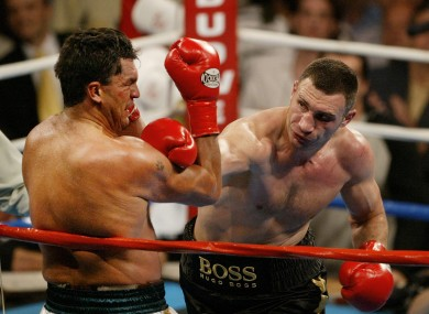 Corrie Sanders (left) in action against Vitali Klitschko in 2004.
