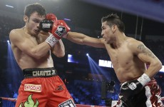 Martinez survives knockdown to dethrone Chavez