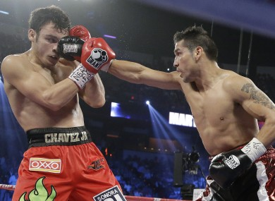 Martinez lands a punch against Chavez Jr last night.