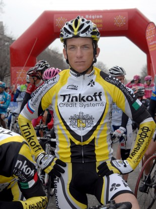 Tyler Hamilton, rests before the start of the second stage of Etoile de Besseges race between Nimes and Saint-Ambroix in 2007.