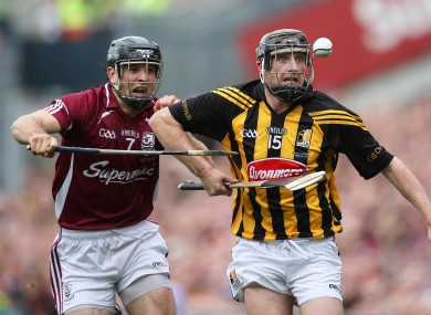 David Collins chases Kilkenny's Aidan Fogarty.