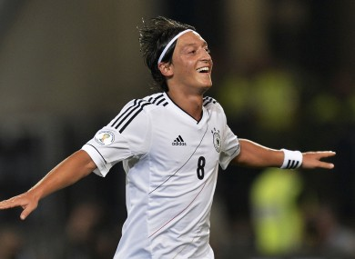 Germany's man of the match Mesut Oezil celebrates after scoring.