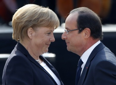 German Chancellor Angela Merkel and French President Francois Hollande greet each other in Ludwigsburg, Germany