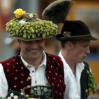 A man wearing traditional Bavarian clothes and a decorated hat with hops. (AP Photo/Matthias Schrader)