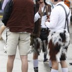 Men wear the traditional Tracht - lederhosen (leather shorts) and embroidered braces. (AP Photo/Matthias Schrader)