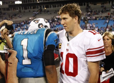 Carolina Panthers' Cam Newton (1) meets New York Giants' Eli Manning (10) after the game.