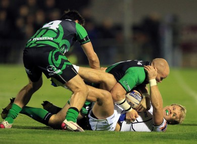 Connacht's Johnny O'Connor and Tiernan O'Halloran tackle Fionn Carr of Leinster.
