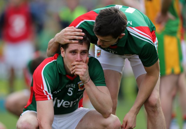 Lee Keegan is consoled by Jason Doherty at the end of the game 23/9/2012