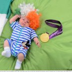 3 September 2012; Patrick Moran Laffan, 10 weeks, from Rathdrum, Wicklow, nephew of Boccia player Padraic Moran, with Jason Smyth's gold medal at the team lodge. London 2012 Paralympic Games, Team Lodge, Stratford, London, England. Picture credit: Brian Lawless / SPORTSFILE
