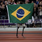 Brazil's Alan Fonteles Cardoso Oliveira celebrates after beating Oscar Pistorius in the Men's 200m T44 final. (AP Photo/Emilio Morenatti)