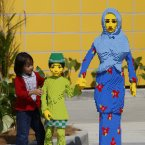 A girl stands beside Lego figures during a preview at Legoland Malaysia in Nusajaya, Johor, southern Malaysia. Legoland Malaysia is Asia's first Legoland theme park and is to open on Sept. 15. (AP Photo/Lai Seng Sin)