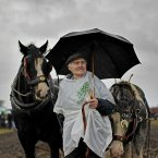 John O'Sullivan, from Skibbereen in West Cork, holds onto the plough horses. Image: Julien Behal/PA Wire