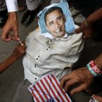 Supporters of a Insaf Student Federation burn an effigy of US President Barack Obama. (AP Photo/Fareed Khan)