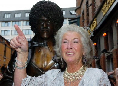 Philomena in front of the statue of her son on the corner of Grafton Street in Dublin in 2005.