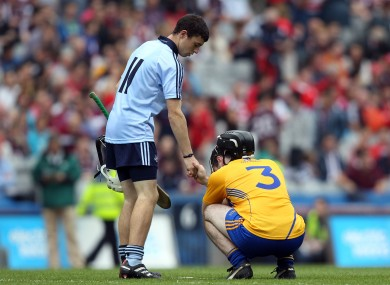 Dublin's Sean Tracy shakes hands with Brian Carey of Clare following the All-Ireland MHC semi-final.