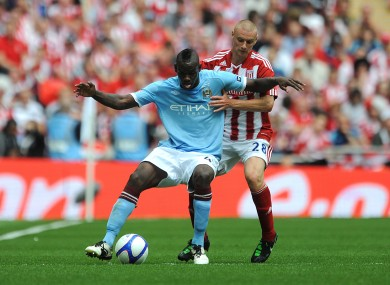 Stoke City's Andy Wilkinson (right) and Manchester City's Mario Balotelli battle for the ball. File picture.