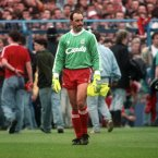 Liverpool goalkeeper Bruce Grobbelaar looks around the ground in disbelief as the tragic events unfold around him (Photo: Ross Kinnaird/EMPICS Sport)