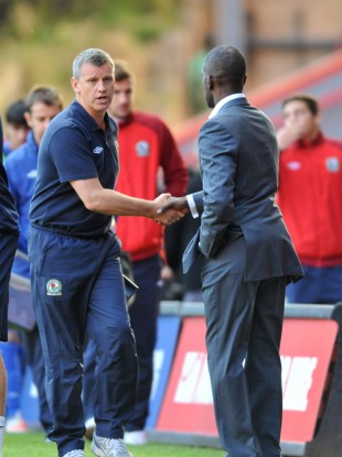 Black shakes hands with Charlton boss Chris Powell after yesterday's draw.