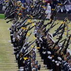 South Korean honor guard soldiers perform during the 64th anniversary of Armed Forces Day at the Gyeryong military headquarters in Gyeryong. (AP Photo/Lee Jin-man)
