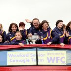 Wexford players and management with the O'Duffy Cup onboard their bus.