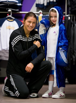 adidas ambassador Katie Taylor, pictured with Alice Brannigan, 6, during a visit to the newly refitted Life Style Sports store at Dundrum Town Centre
