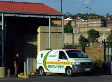 An ambulance leaves Johannesburg's central prison after an explosion near the prison.